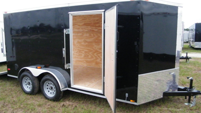 Enclosed motorcycle trailer with foldable motorcycle trailer with low profile enclosed trailer