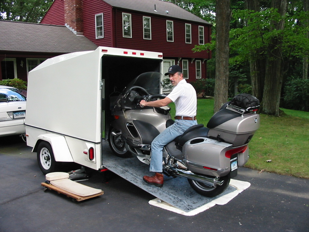 Enclosed motorcycle trailer with pull behind motorcycle trailer with small cargo trailers