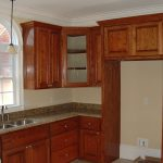 : Kitchen locker new can selected to kitchen decoration with brown colored for ceiling be equipped unique crown moulding and to unique granite countertop equipped small kitchen sink. can try