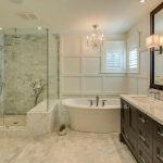 : Large master bathroom ideas with glass walk in shower and luxury bathtub ideas you can be equipped crystals chandelier and wall lighting fixtures and marble countertops plus framed bathroom mirror