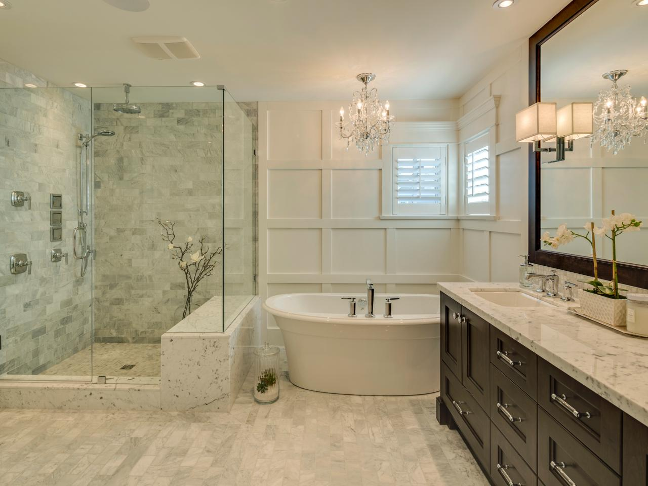 Large master bathroom ideas with glass walk in shower and luxury bathtub ideas you can be equipped crystals chandelier and wall lighting fixtures and marble countertops plus framed bathroom mirror