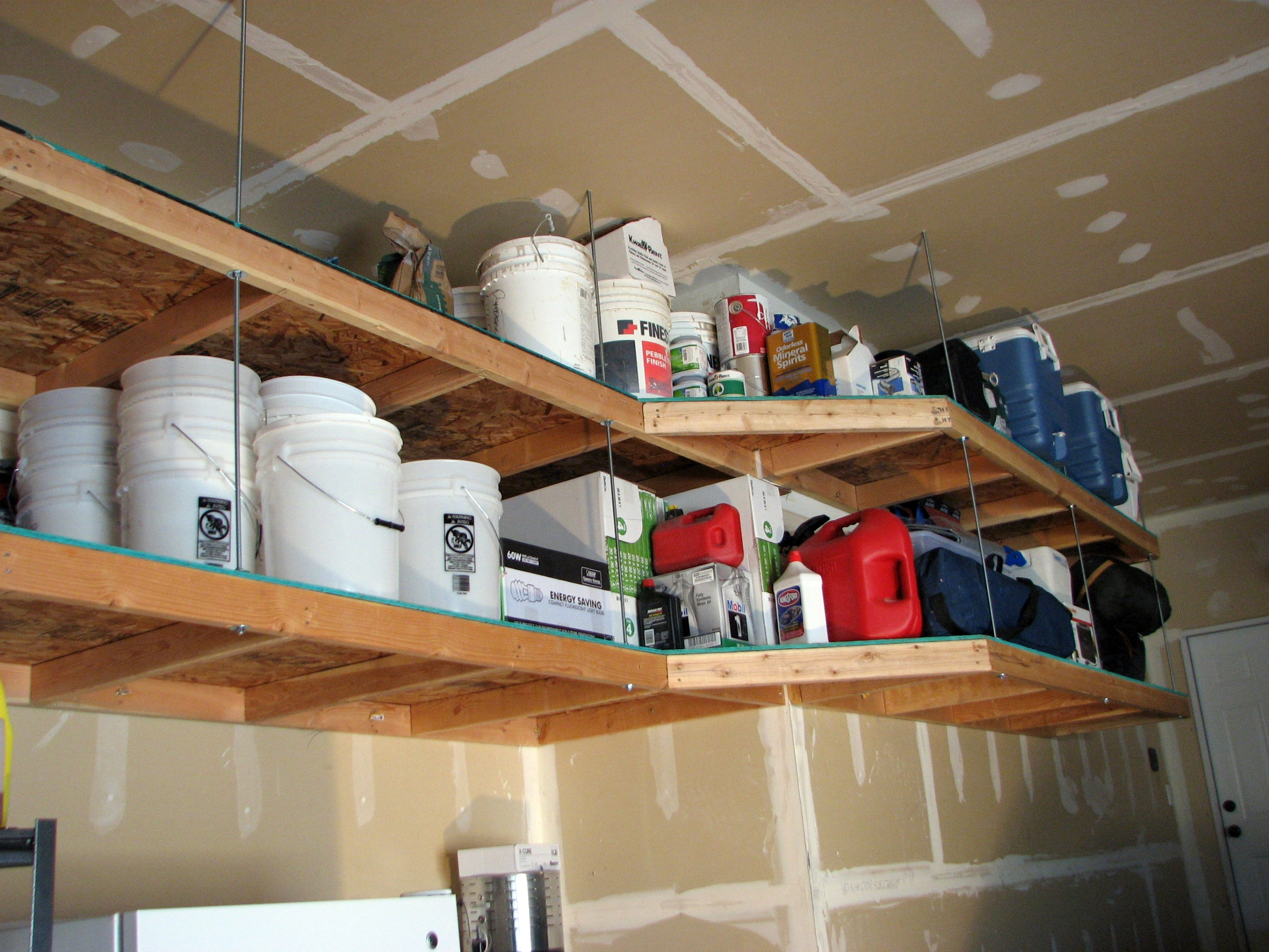 Overhead garage storage with garage ceiling hangers with hanging garage storage systems with garage shelving and storage