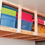 : Overhead garage storage with garage shelving that hangs from the ceiling with diy hanging garage shelves