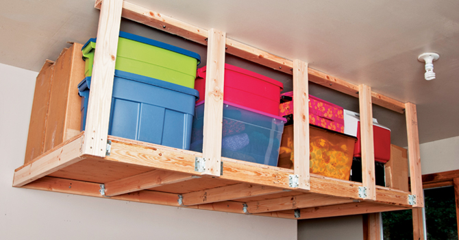 Overhead garage storage with garage shelving that hangs from the ceiling with diy hanging garage shelves