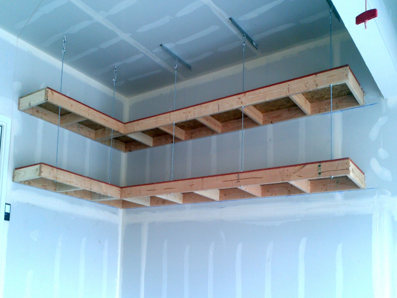Overhead garage storage with hanging shelves from garage ceiling with garage wall storage solutions
