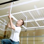 : Overhead garage storage with saferacks installation with wall to ceiling storage with elevated garage storage
