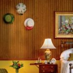 : Wall paneling with prefinished wall board with decorative indoor paneling