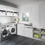 : Laundry room cabinets and plus laundry storage and plus custom kitchen cabinets and plus cabinets over washer and dryer